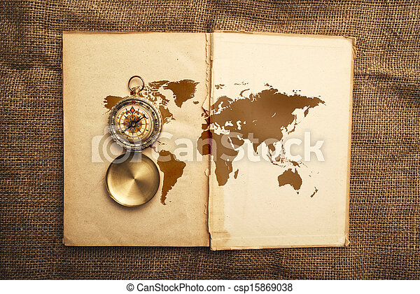 Old open book with compass and world map vintage open book old open book with compass and world map stock photo gumiabroncs Images