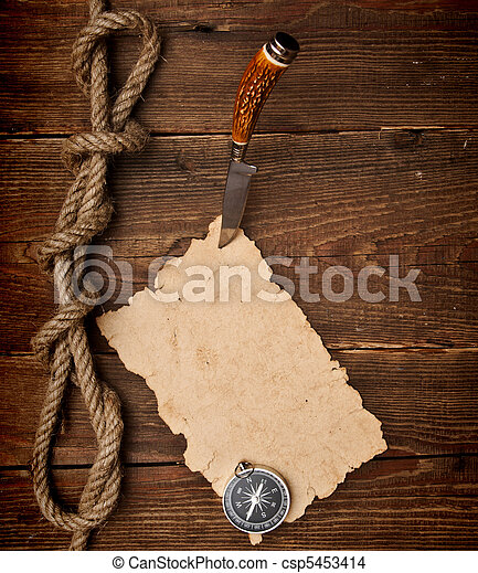 Old paper pinned to a wooden wall with a knife - csp5453414