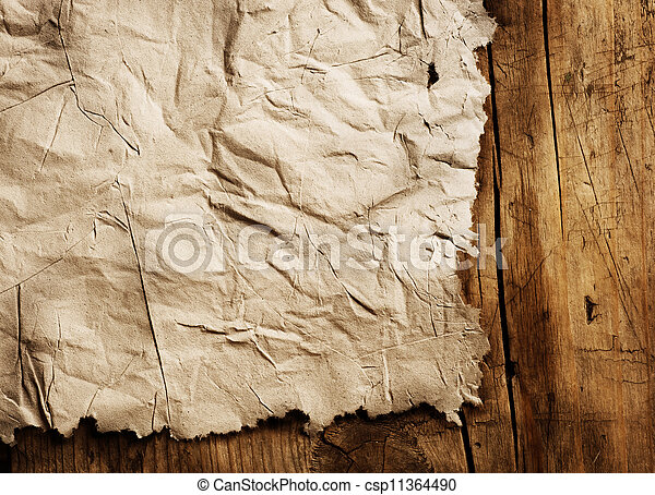 Old Paper sheet over wooden background closeup - csp11364490
