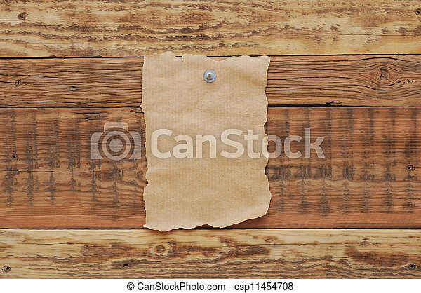 Old paper tacked to a wood wall  - csp11454708