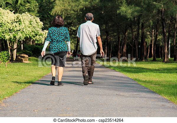 Old people walking in the park - csp23514264
