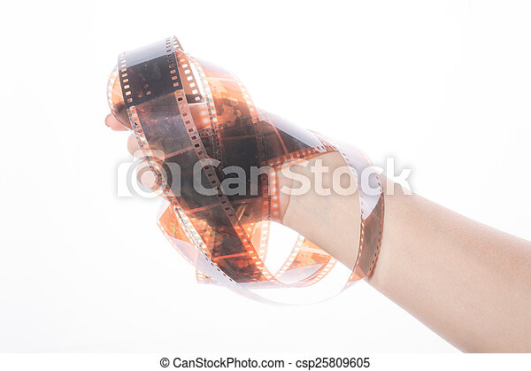 Old photographic film in the hand on white background - csp25809605
