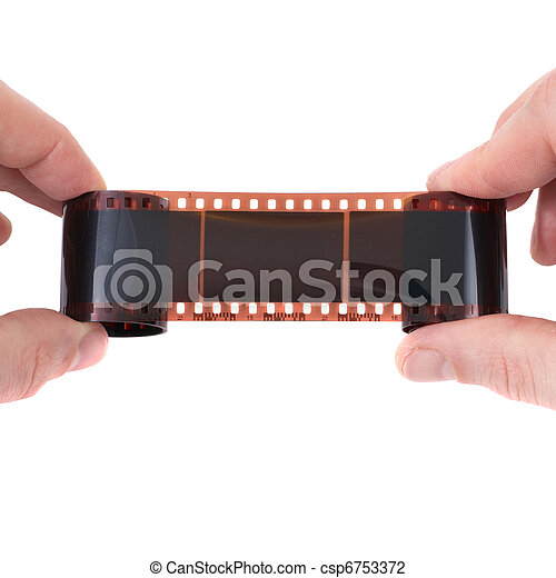 Old photographic film in the hands - csp6753372