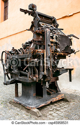 Old printing press - rotary machine - polygraphic equipment - big cog wheel
