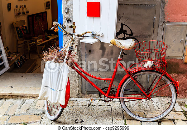 Old Red Bicycle at the Shop Door in Rovinj, Croatia - csp9295996