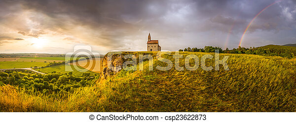 Old Roman Church at Sunset in Drazovce, Slovakia - csp23622873