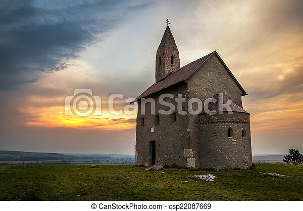 Old Roman Church at Sunset in Drazovce, Slovakia - csp22087669