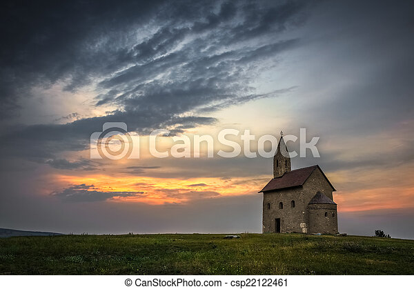 Old Roman Church at Sunset in Drazovce, Slovakia - csp22122461