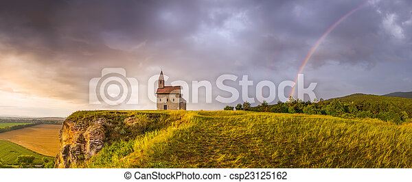 Old Roman Church at Sunset in Drazovce, Slovakia - csp23125162