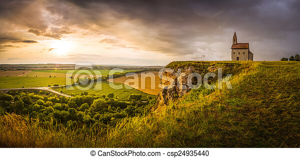 Old Roman Church at Sunset in Drazovce, Slovakia - csp24935440