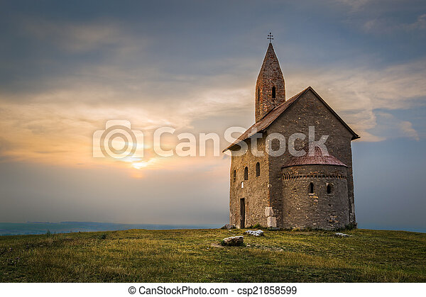Old Roman Church at Sunset in Drazovce, Slovakia - csp21858599