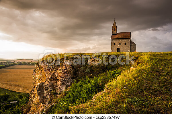 Old Roman Church at Sunset in Drazovce, Slovakia - csp23357497
