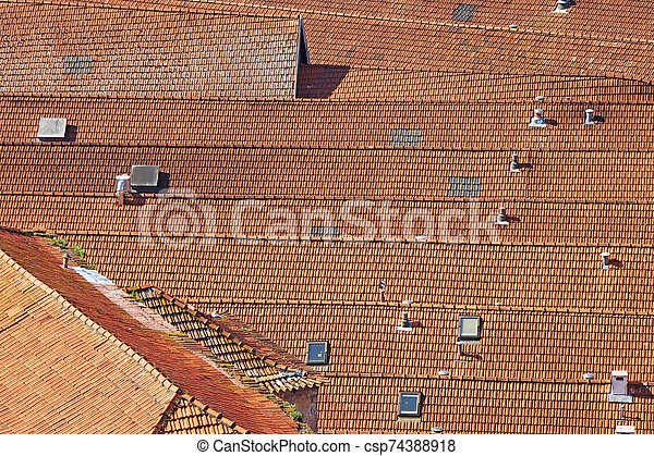 Old roof with old roof tiles - csp74388918