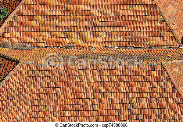 Old roof with old roof tiles - csp74388866