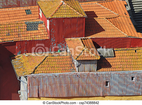Old roof with old roof tiles - csp74388842