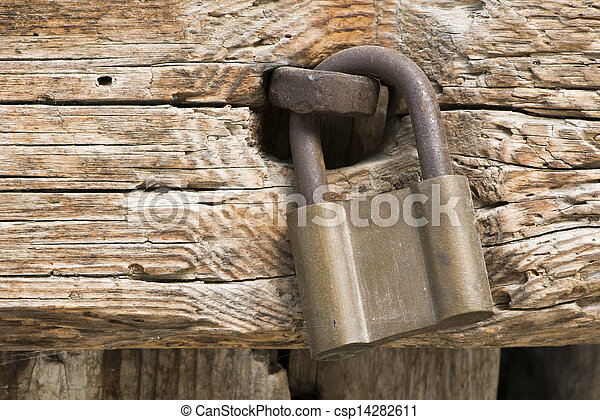 Old rotten board with padlock - csp14282611