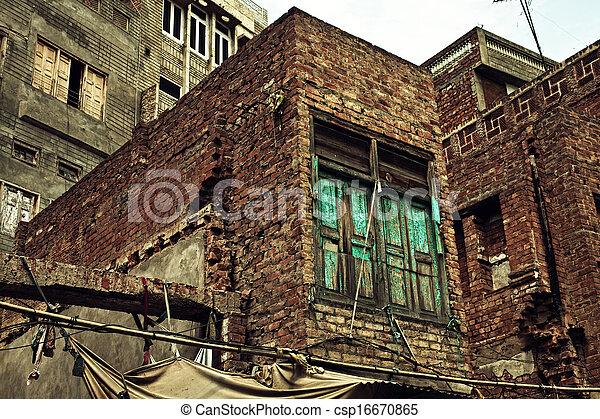 Old Ruined Brick Apartment Building   Csp16670865