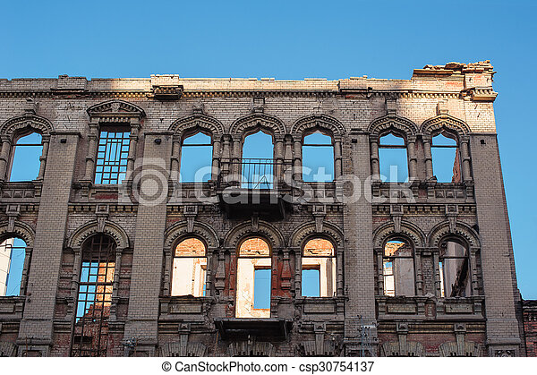 Old ruined building with no windows and roof - csp30754137