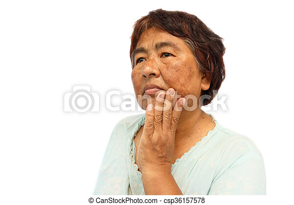 old rural woman with blemish , acne , mole and wrinkle on her face ( isolated background and blank area at left side ) ( anti-aging concept ) - csp36157578
