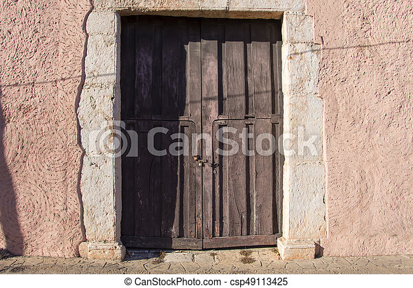 Old rustic colonial door and wall - csp49113425 & Old rustic colonial door and wall. Old wooden rustic door with locks ...
