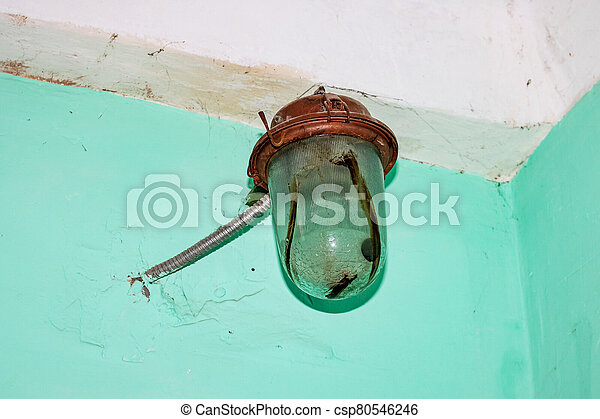 Old rusty lamp on a green wall - csp80546246