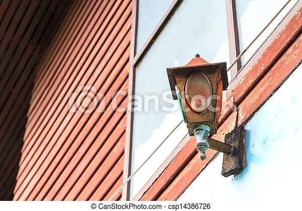old rusty lamp on wall - csp14386726
