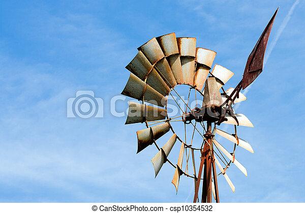 Old rusty windmill at rural farm - csp10354532