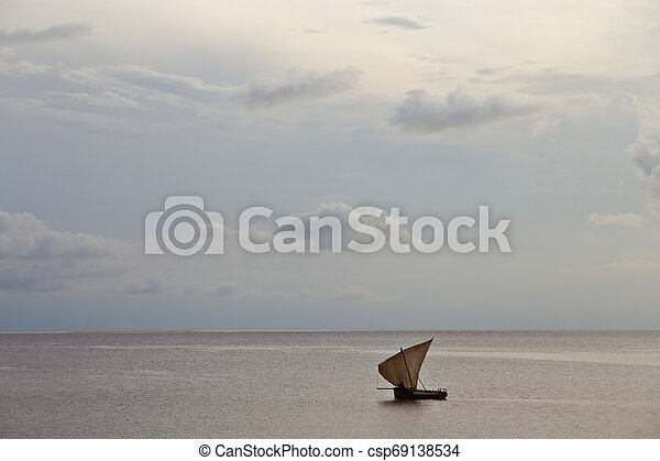 old sailing boat in the ocean at sunset - csp69138534