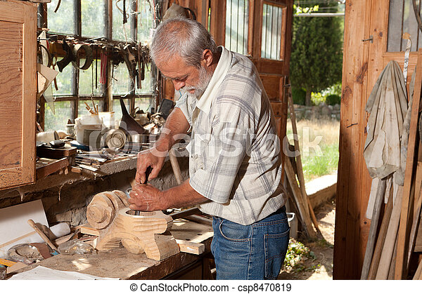Old shed and skilled carpenter - csp8470819