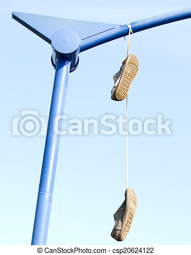 Old shoes hanging from their laces