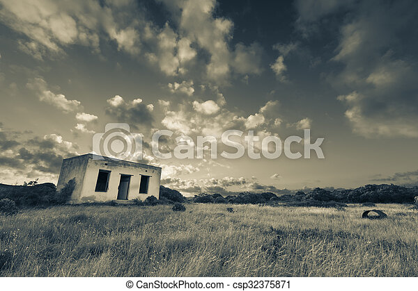 Old small deserted house in field with cloud sunset landscape artistic conversion - csp32375871