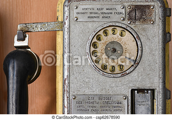 Old Soviet telephone payphone with a disk dialer, call special services, retro, close up - csp62678590