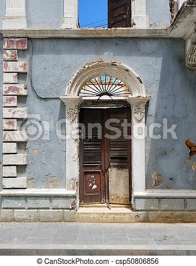 Old Spanish Door With A Door Knocker In San Juan, Puerto Rico.   Csp50806856