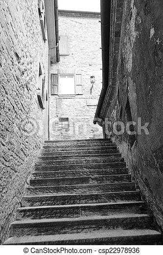 Old stairs on medieval narrow street - csp22978936