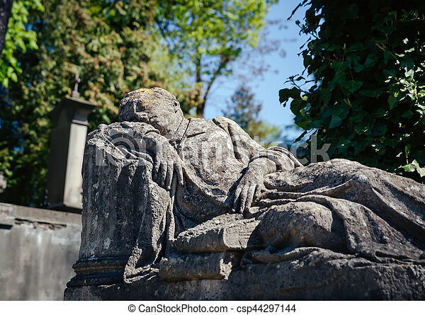 Old statue on grave in Lviv - csp44297144
