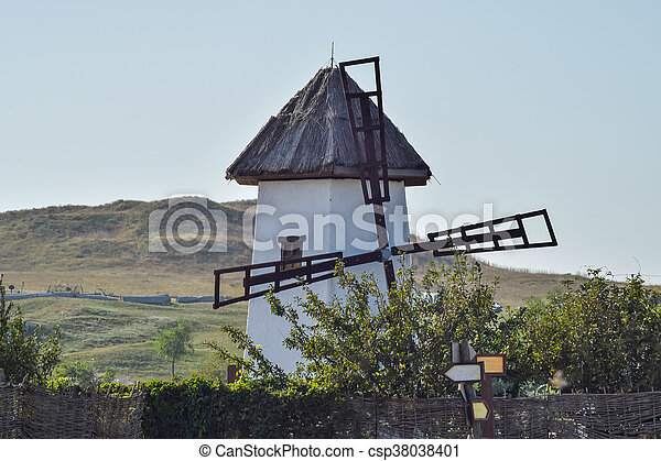 Old stone mill with a thatched roof - csp38038401