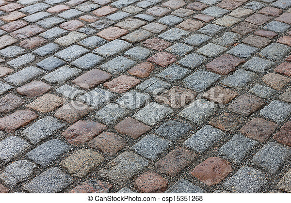 Old stone paved avenue street road - csp15351268