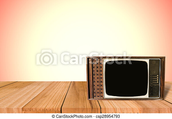 Old Style Photo. Classic vintage and retro TV on the table with wall background - csp28954793