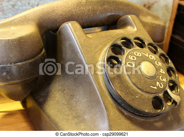 old telephone with rotary dial - csp29099621