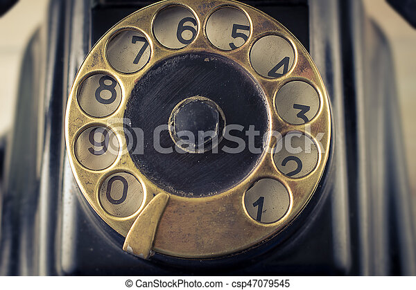 old telephone with rotary dial - csp47079545