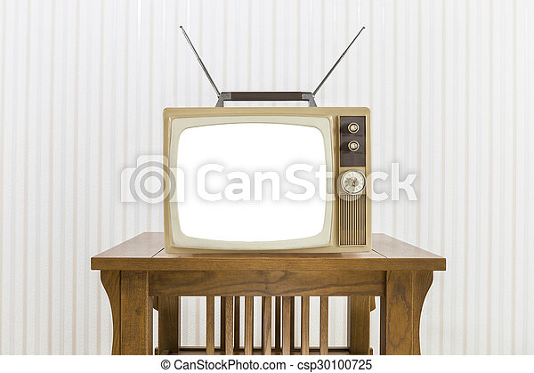 Old Television with Antenna on Wood Table with Cut Out Screen - csp30100725