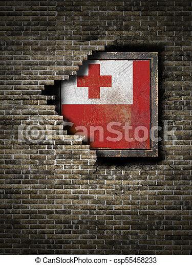 Old Tonga flag in brick wall - csp55458233