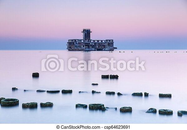 Old torpedo launcher and breakwater near Gdynia, Poland - csp64623691