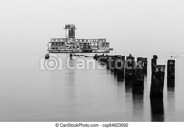 Old torpedo launcher and breakwater near Gdynia, Poland - csp64623692