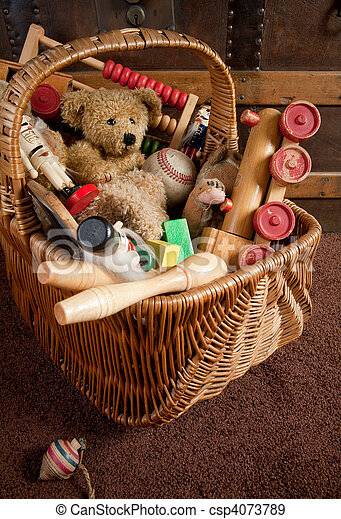 Old toys in a basket - csp4073789