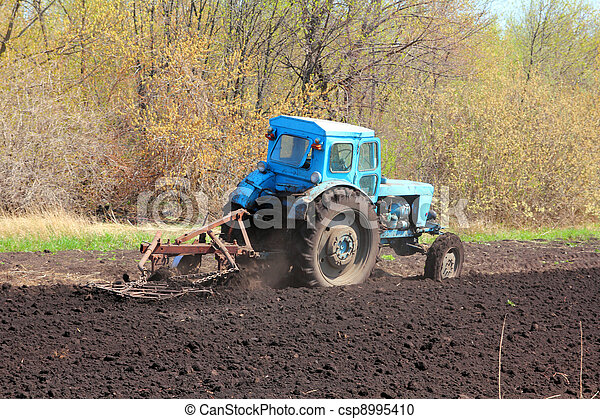old tractor with plough - csp8995410