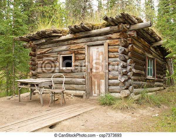 Old traditional log cabin rotting in Yukon taiga - csp7373693