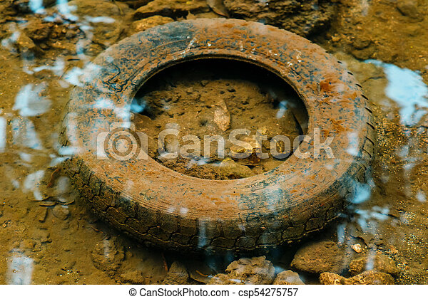 old tyre in the water, ecology concept - csp54275757