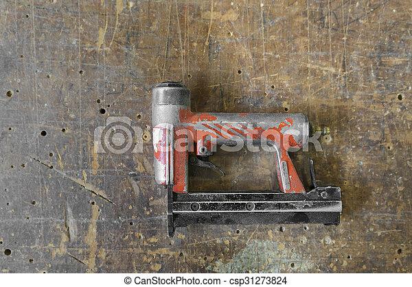 Old used red air nailer or nail gun carpenter tools old stock old used red air nailer or nail gun carpenter tools stock photo prinsesfo Images