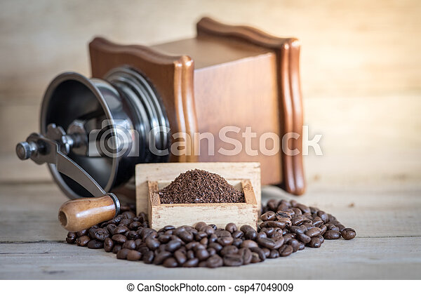old vintage coffee grinder with coffee beans
